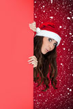Funny santa girl, blank billboard and snow Royalty Free Stock Photography