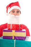 Funny Santa Girl looking to a lots of gifts, isolated on white, Stock Photos