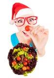 Funny Santa girl playing with salad Royalty Free Stock Photos