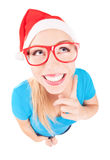 Funny Santa girl pointing up Royalty Free Stock Image