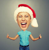Funny santa girl showing thumbs up Stock Photography