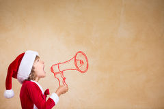 Funny Santa kid with drawn megaphone Stock Photo