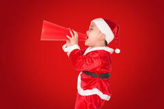 Funny Santa kid with megaphone Stock Photography