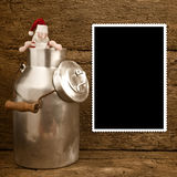 Funny Santa and milk can Christmas frame Royalty Free Stock Image