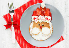 Funny santa pancake with mascarpone and strawberry. Creative idea for Christmas kid breakfast - funny santa pancake with mascarpone and strawberry Stock Photos