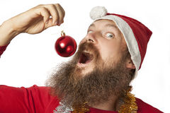 Funny santa with red Christmas Ball Stock Photo