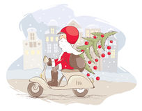 Funny Santa rides through the old town Royalty Free Stock Photo