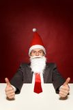 Funny santa showing thumbs up Stock Photography