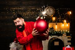 Funny Santa wishes Merry Christmas and Happy new year. Sparkle blast. Hipster Santa claus. Bomb text copy space. Bomb. Emotions royalty free stock image