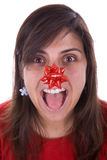 Funny santa woman with red ribbon in her nose Royalty Free Stock Image