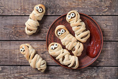 Funny sausage meatball mummies wrapped in dough Stock Photo