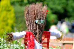 Funny Scarecrow Wearing Sunglasses. Funny Scarecrow. Picture is taken at: 'Scarecrows go Racing' charity collection parade in Winkfield, United Kingdom Royalty Free Stock Photo
