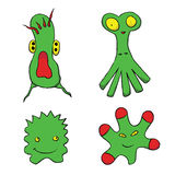 Funny and scary green cartoon monsters/aliens Stock Photos