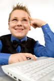 Funny school boy with laptop isolated on white Royalty Free Stock Images