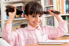Funny school girl with pigtails Stock Images