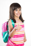 Funny school girl showing thumbs up Royalty Free Stock Photography