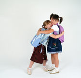 Funny school girls. Hugging each other Royalty Free Stock Photo