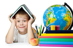 Funny schoolboy with a book on her head. isolated Royalty Free Stock Images
