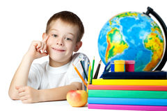 Funny schoolboy with books and pencils Royalty Free Stock Images