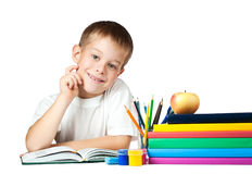 Funny kid with books and pencils Stock Photography