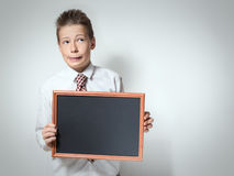 Funny schoolboy with empty chalkboard Stock Photography