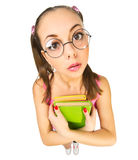 Funny schoolgirl with books Stock Photo