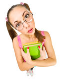 Funny schoolgirl with nerd glasses and books Stock Photography