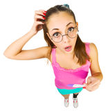 Funny schoolgirl in nerd glasses with positive pre Stock Images