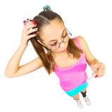 Funny schoolgirl with positive pregnancy test Stock Photos