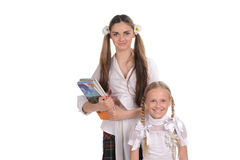 Funny schoolgirls with books in the hand Royalty Free Stock Photos