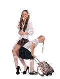Funny schoolgirls with books in the hand Stock Image