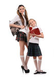Funny schoolgirls with books in the hand Stock Photography