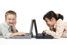Funny Schoolwork. Two kids doing their schoolwork on a laptop. It's a funny exercise Stock Images