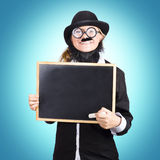 Funny science teacher holding blank chalkboard. Funny science school teacher smiling while holding a blank chalkboard in a scientific education copyspace concept Stock Photos