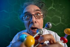 Funny scientist with model molecules Royalty Free Stock Photos