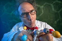 Funny scientist with molecules model. Funny scientist with chloroform molecular structure model stock images