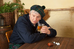 Funny Scotsman drinking whisky Royalty Free Stock Photo