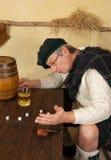 Funny Scotsman drinking whisky Royalty Free Stock Photo