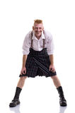Funny Scotsman isolated on white. Photo ginger Scotsman in a kilt on white background Stock Photo
