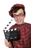 Funny scotsman with movie board Royalty Free Stock Image