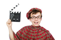 Funny scotsman with movie board Stock Photography