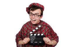 Funny scotsman with movie board Royalty Free Stock Photography