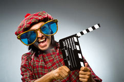 Funny scotsman with movie Stock Images