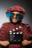 Funny scotsman with movie Stock Image