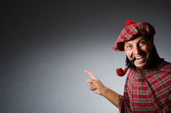 Funny scotsman. With smoking pipe royalty free stock images