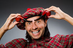 Funny scotsman. With smoking pipe Stock Photography
