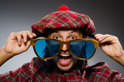 Funny scotsman in traditional Stock Photo