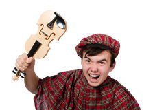 Funny scotsman with violin Royalty Free Stock Photos
