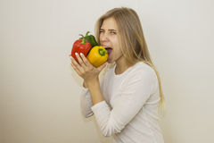 Funny scrunching of peppers Stock Photography