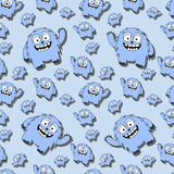 Funny seamless pattern with cartoon monsters. In blue colours Royalty Free Stock Photos